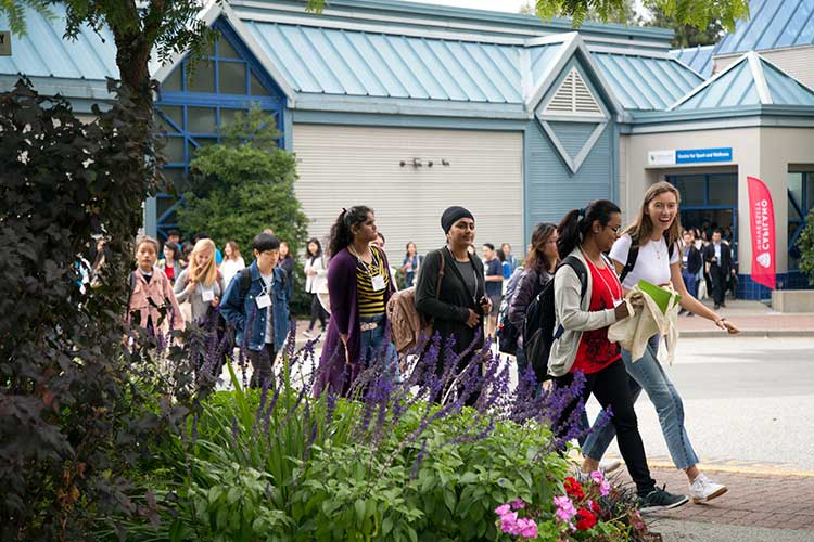 Students walk out of the Centre for Sport and Wellness during a break in the Centre for International Experience's International Student Orientation on Thursday, Aug. 31, 2018.