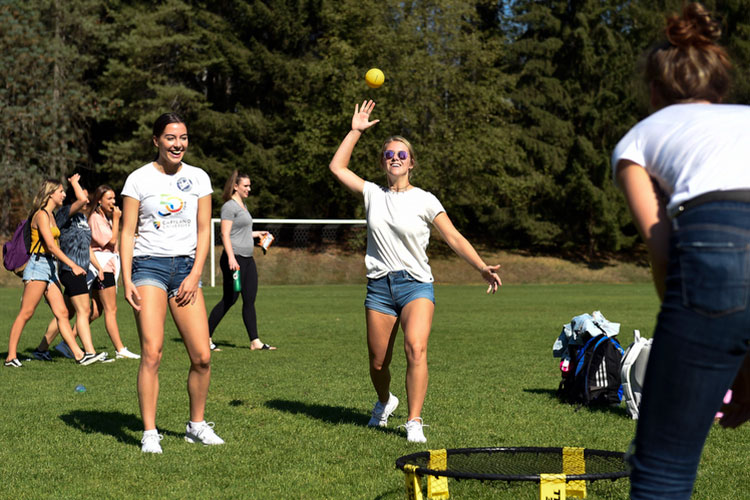 Students play Spikeball before a Capilano Blues exhibition soccer game on Wednesday, Sept. 5, 2018.