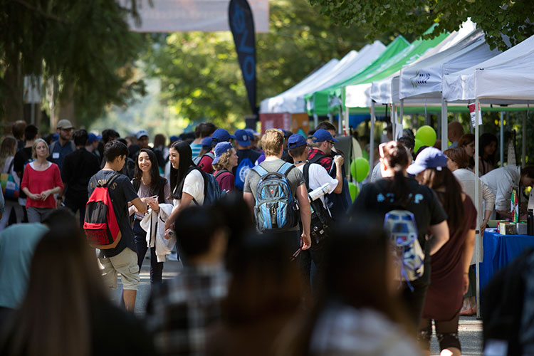 Students mingle on campus during the orientation street party on Tuesday, Sept. 4, 2018.