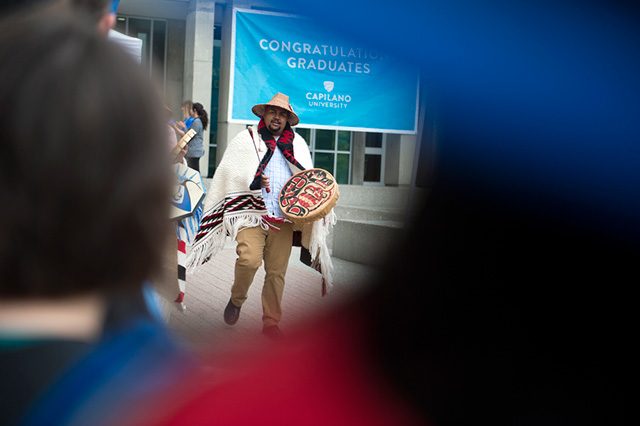 Willie Lewis, First Nations Recruitment Advisor, leads students and employees to a Convocation Ceremony at Capilano University on Tuesday, June 5, 2018.