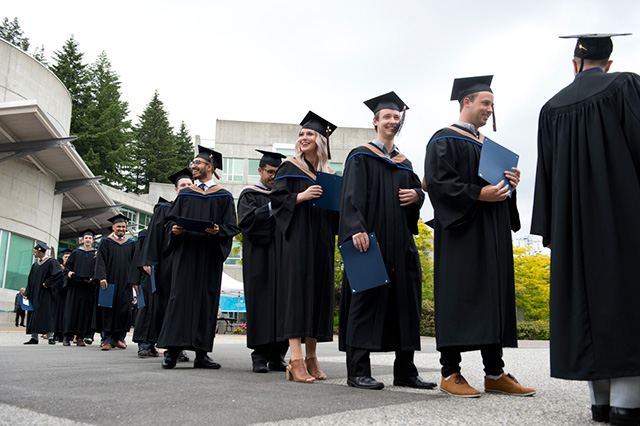 Students enter their Convocation Ceremony at Capilano University on Tuesday, June 5, 2018.