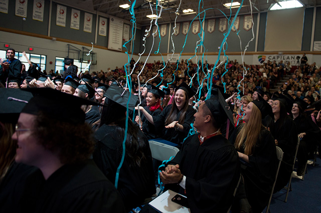 Students, families and employees celebrate at the end of a Convocation Ceremony at Capilano University on Monday, June 4, 2018.