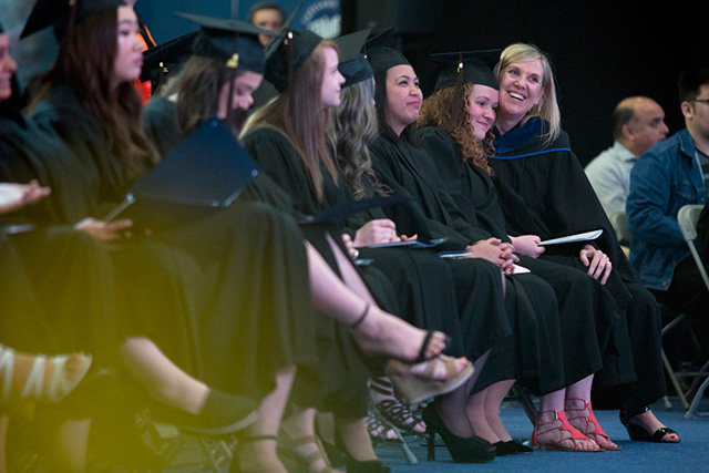 School of Business instructor Karen Okun, right, hugs a student during a Convocation Ceremony at Capilano University on Tuesday, June 5, 2018.