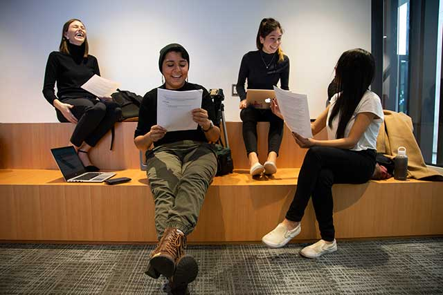 Students practice a presentation in the new Learning Commons on Thursday, Nov. 8, 2018.